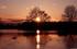 coucher du soleil sur les prés inonder d